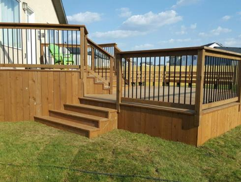 Alcatraz Fences & Decks Inc Wood Deck Metal Spindles 1